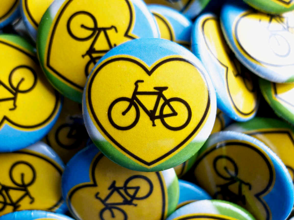 one inch buttons with heart shaped bicycle sign